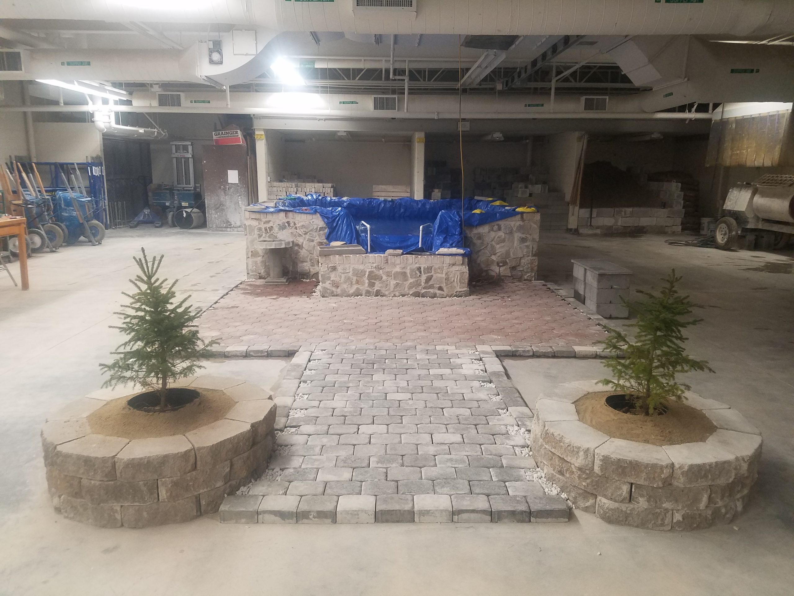 Coy pond with paver patio and planters